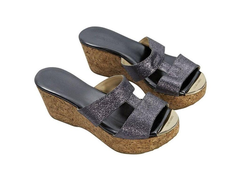 69e47a83d6c Product details  Silver glittered platform sandals by Jimmy Choo. Open toe  with metal plate
