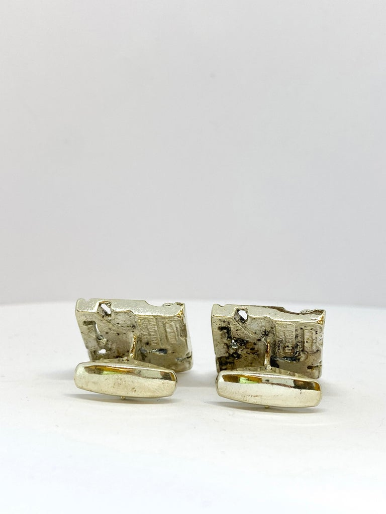 Silver Jorma Laine Turun Hopea 1976 Cufflinks 830 Silver. Made in Finland Turun Hopea.  Jorma Laine (1930-2002) was a Finnish jewelry designer, whose work in bronze and silver (more seldom gold) is easily recognizable. He developed a style of his