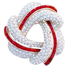 Silver Knot Brooch w Crystal Pavé & Red Crystal Baguettes by Nolan Miller, 1990s