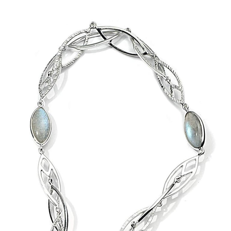 34 Inches of Interlaced Spring Sterling Silver Necklace with 24.7CTS of Labradorite, and 0.04CTS of Diamond.