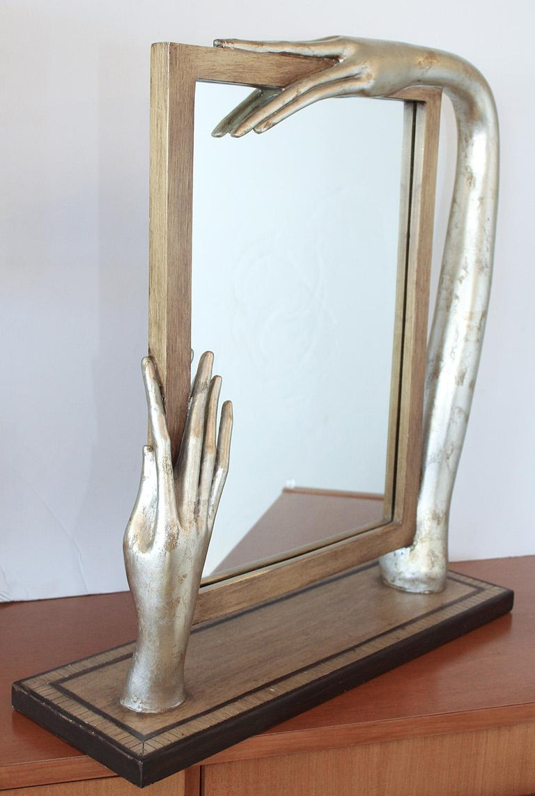 Silver leaf and painted wood mirror with surrealistic elongated arm and hands in the manner of Amadeo Modigliani, circa 1980. Very good condition.