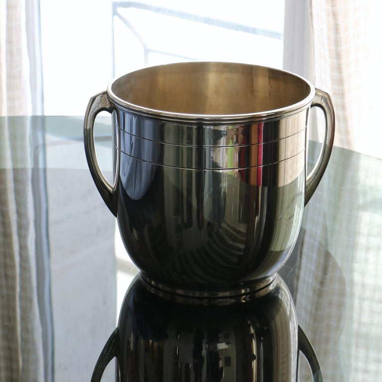 Silver metal champagne bucket with clean lines.
