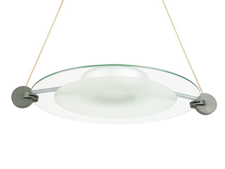 This Postmodern pendant is made from a grey plastic and silver metal structure with a round sandblasted glass shade. It features 2 lamp E27 sockets and remains in very good condition.