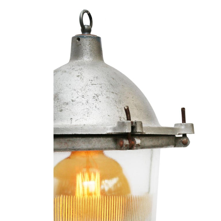 Industrial hanging lamp. Silver grey cast aluminium striped glass.  Weight: 7.0 kg / 15.4 lb  Priced per individual item. All lamps have been made suitable by international standards for incandescent light bulbs, energy-efficient and LED bulbs.
