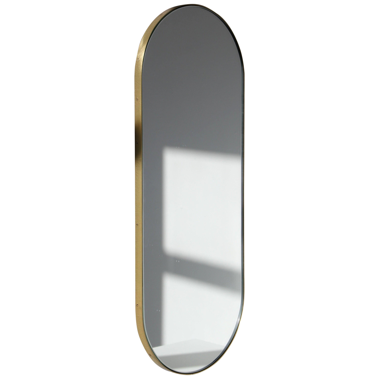 Capsula™ Capsule shaped Elegant Narrow Mirror with a Brass Frame