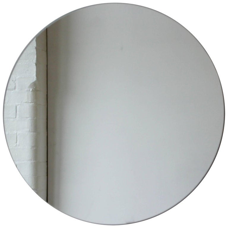Delightful crafted silver tinted round mirror frameless with a floating effect. Design and handcrafted in London UK.   Supplied fully fitted with a specialist hanging system for an easy installation.  Measures: Diameter 60cm/23.6
