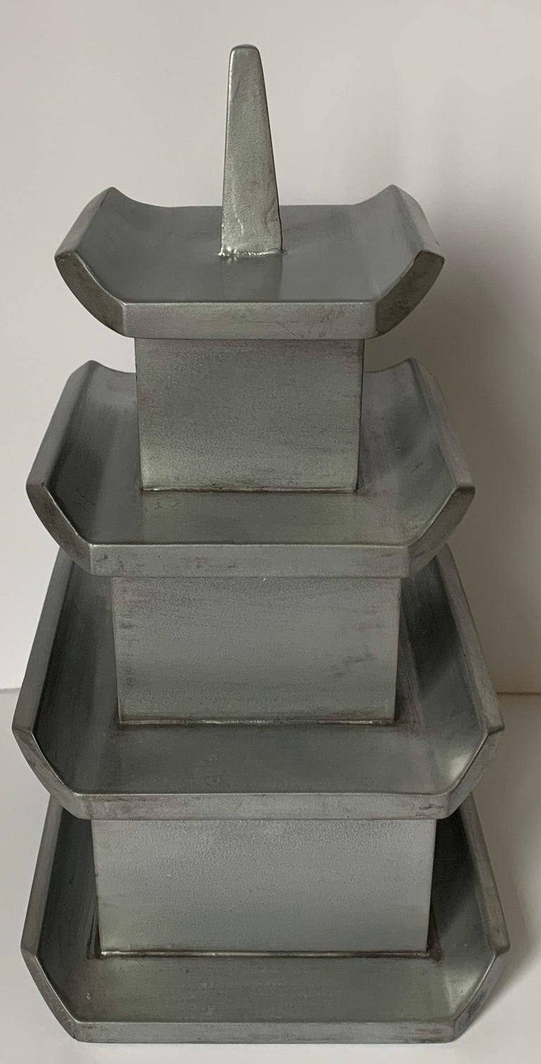 Custom silver painted wooden pagoda box. Three tiered storage compartments plus pagoda finial lid. No makers mark.