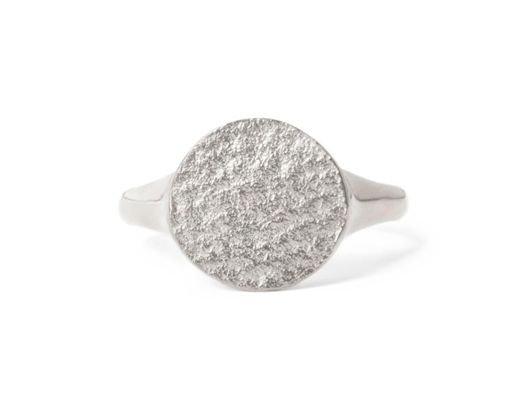 This textured signet ring crafted in solid sterling silver has a unique shimmering texture on the face and a high polish finish on the band for a comfortable fit.  Available in UK size M 1/2 (equivalent to US size 6 1/4), can be resized upon