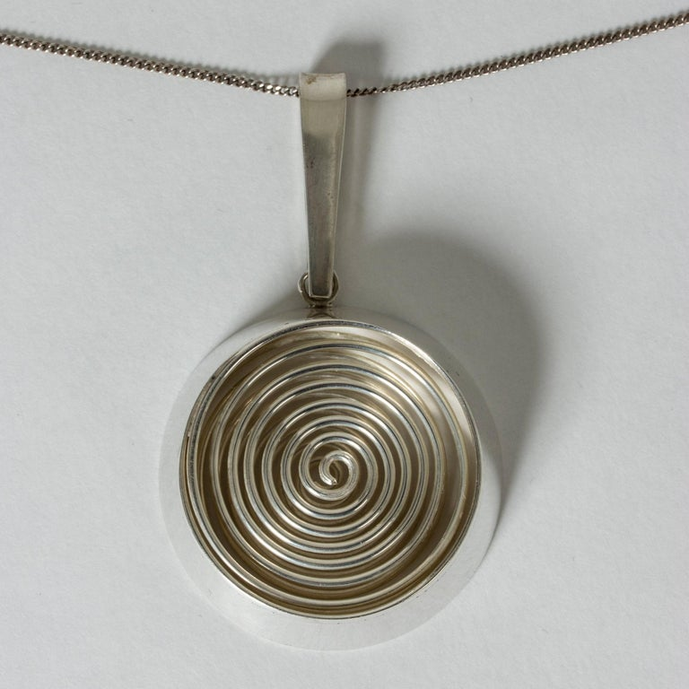 Striking silver pendant from Kaplans, with a springy spiral inside. Hypnotic design with great execution.
