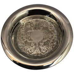 Silver Plate Circular Dish with Embossed Decoration & a Broad Rim