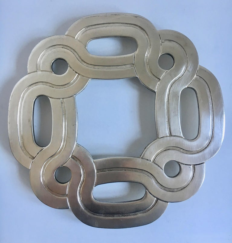 Silver plate Italian trivet - a great decorative pattern, perhaps Celtic. no need to store as this will look great on your counter or hanging on your wall.