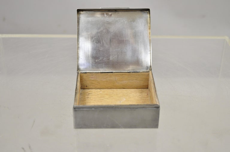 Silver plate Schaaff Heidelberg Germany Art Deco trinket jewelry cigarette box. Item features wood lined interior, original label, clean modernist lines, circa early to mid-1900s. Measurements: 1.5