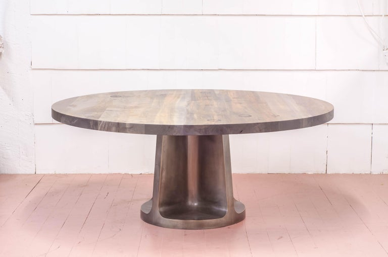 Megalithic cast bronze dining table with a variety of tops and finishes.  Our range of altar-like work aims to explore both contemporary and ancient columnar structures.