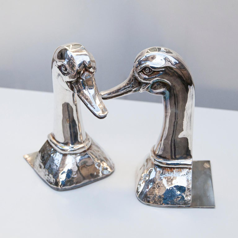 Huge and heavy silver plated bookends made by Valenti in the 1970s  They look a sculpture and will bring glamour to your home.