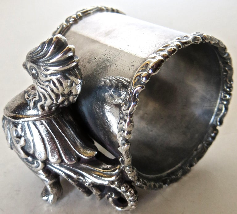 Listed is a silver plated figural napkin ring that I have not seen before and is unmarked. I do not think it is from the Victorian era, but I do believe it was manufactured and somewhat later, say 1920s, not a fake or meant to deceive, simply a