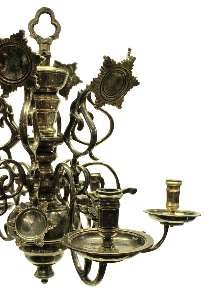 A Flemish silver plated brass chandelier, with reflectors and individually numbered arms.