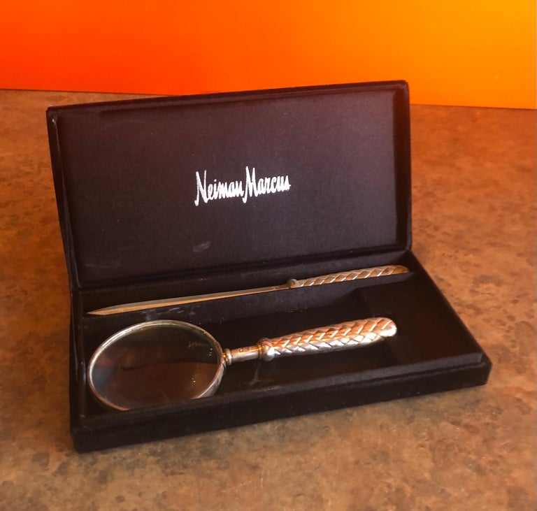 Vintage silver plated magnifying glass and letter opener set by Godinger Silver Art (GSA) for Neiman Marcus, circa 1990s. The set is in very good vintage condition and comes with the original NM box. The handles are in an intricate basket weave