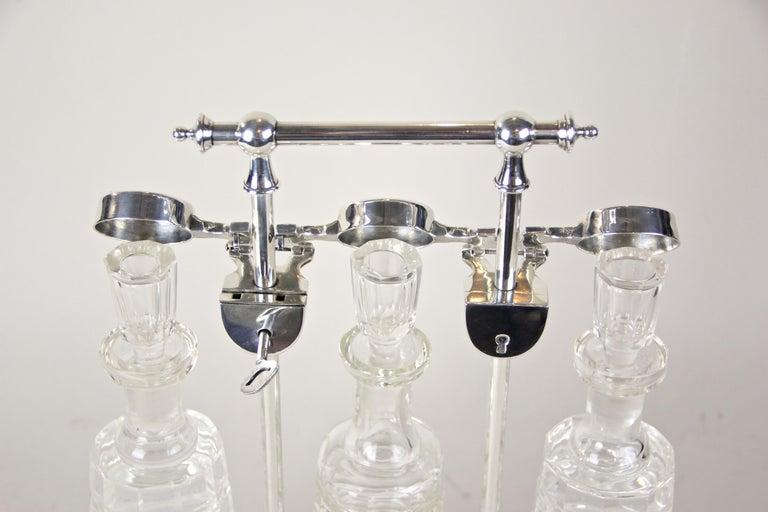 Silvered Silver Plated Three Glass Bottle Tantalus Lockable, Austria, circa 1890