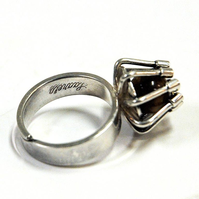 Charming silver ring with a round tigereye stone embraced by