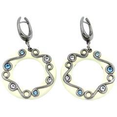 Silver Round Earrings with White Enamel White Topaz and Blue Topaz