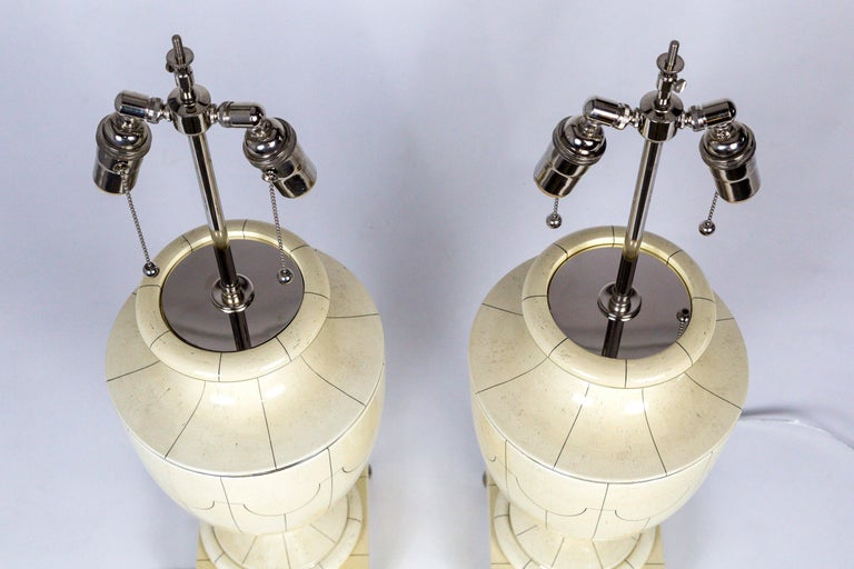 Metal Silver Trimmed Ivory Ceramic Urn Lamps by Jean Roger For Sale