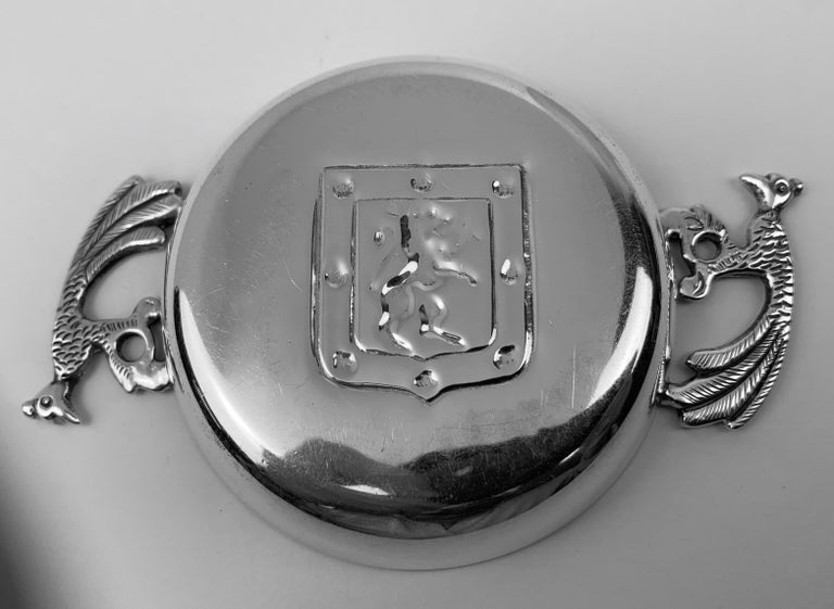 Vintage Silver two handled tastevin. The handles are exotic birds and in the center of the tastevin there is a shield with a rampant lion. Marked on the side .900 (silver) Chile.  The perfect gift for a budding sommelier.