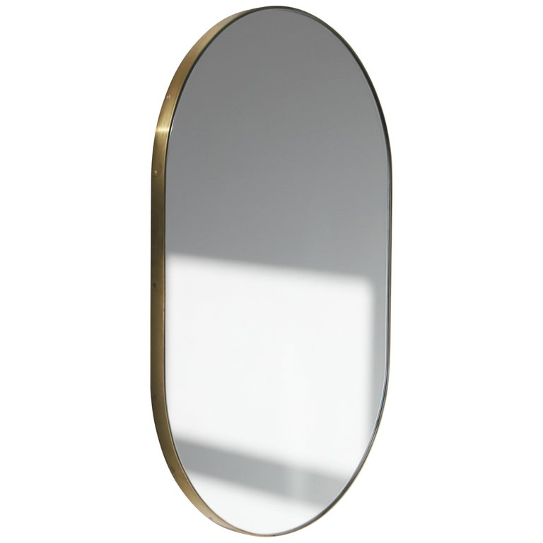 Silver Wide Capsule Mirror with a Brass Frame For Sale