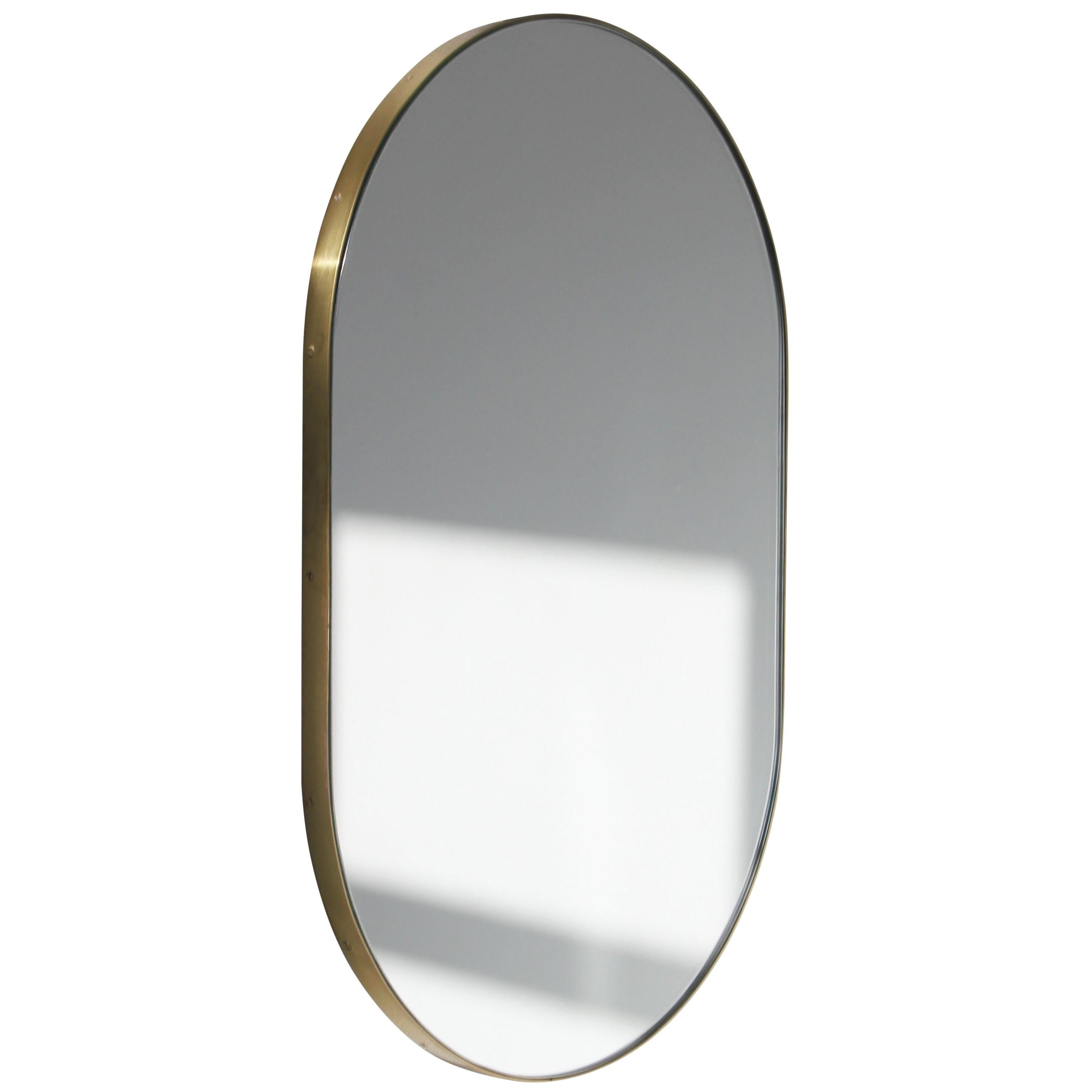 Capsula™ Capsule shaped Wide Elegant Mirror with a Brass Frame