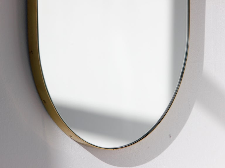 British Silver Wide Capsule Mirror with a Brass Frame For Sale