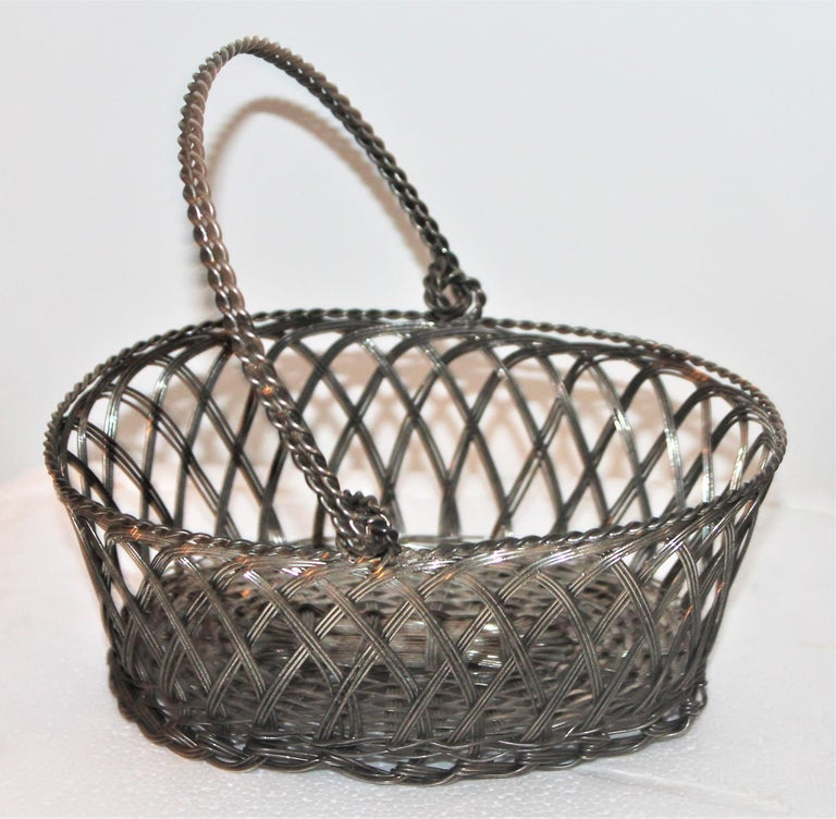 Early 20thc sterling wire basket. The condition is very good and sturdy.