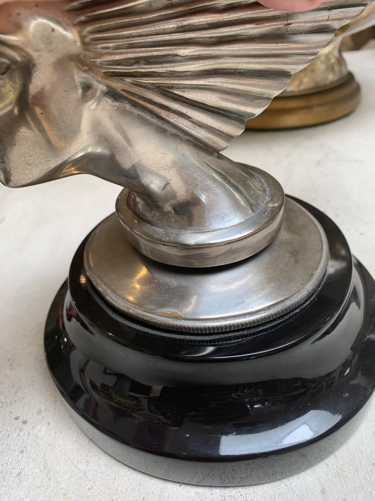 Art Deco sculpture replica of Lalique mascot, silvered bronze, on black marble base.