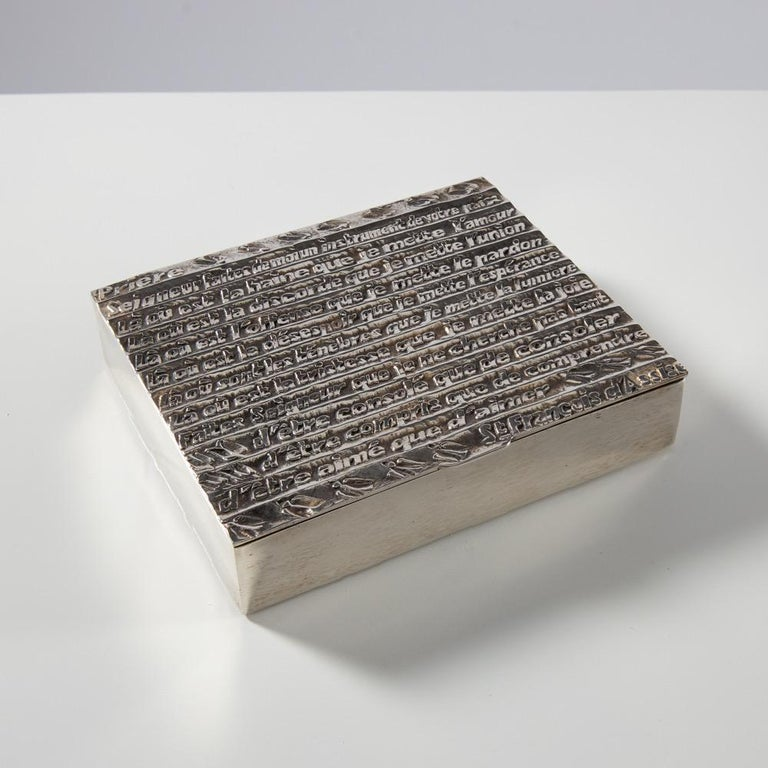 The prayer of Saint Francois, a large silvered bronze box. We can read on the cover  Lord make me the instrument of your peace Where there is hatred, let me sow love Where is the discord, let me put unite  Where there is injury, let me sow