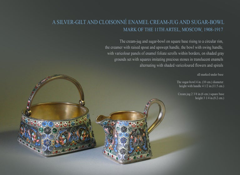 A Silver-gilt and Cloisonné Enamel Cream-jug and Sugar-bowl Mark Of The 11th Artel, Moscow, 1908-1917  The cream-jug and sugar-bowl on square base rising to a circular rim,  the creamer with raised spout and upswept handle, the bowl with swing