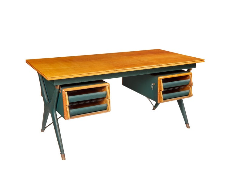 Designed by Silvio Berrone in 1955-1956: wood for the top , dark green vinyl and brass for the structure , Vitrex glass (V. I. S.-Vetro Italiano di Sicurezza) for the drawers.