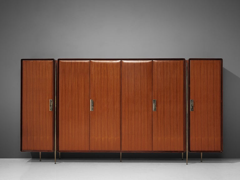 Silvio Cavatorta, wardrobe in mahogany, birch and nickeled brass, Italy, 1950s.  Rare Italian wardrobe in mahogany and birch by Silvio Cavatorta. The dresser has three elements, double doors in the middle and single doors on the sides, divided by