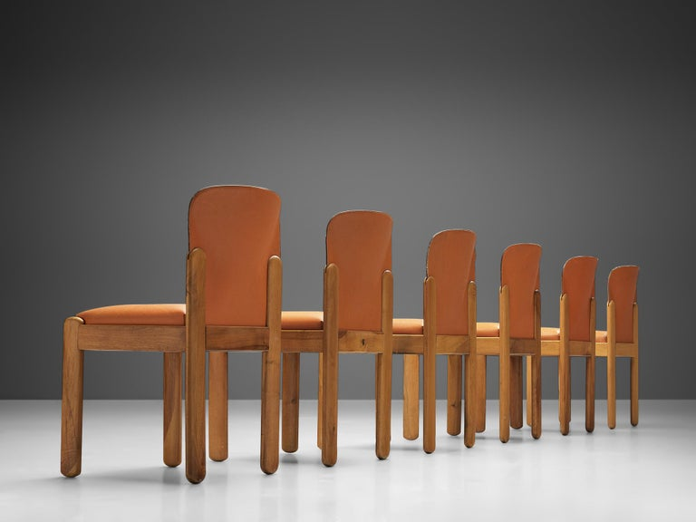 Silvio Coppola for Bernini Italy, set of six chairs, cognac leather and stained beech, Italy, 1960s.  This set of six chairs is designed by Italian designer Silvio Coppola. These chairs have a cubic and architectural appearance. The base consist of