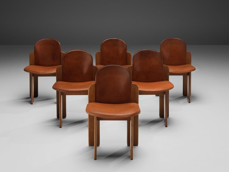Silvio Coppola, set of six dining chairs, model 330, walnut, leather, Italy, 1960s  This model of dining chairs by Silvio Coppola reminds of the model '330' he designed for Bernini. Yet these particular chairs are different in the way seat and