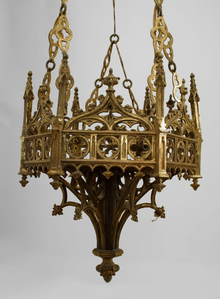 Two similar English Gothic Revival style (19th century) bronze doré six-sided filigree sanctuary fixtures. Priced each.