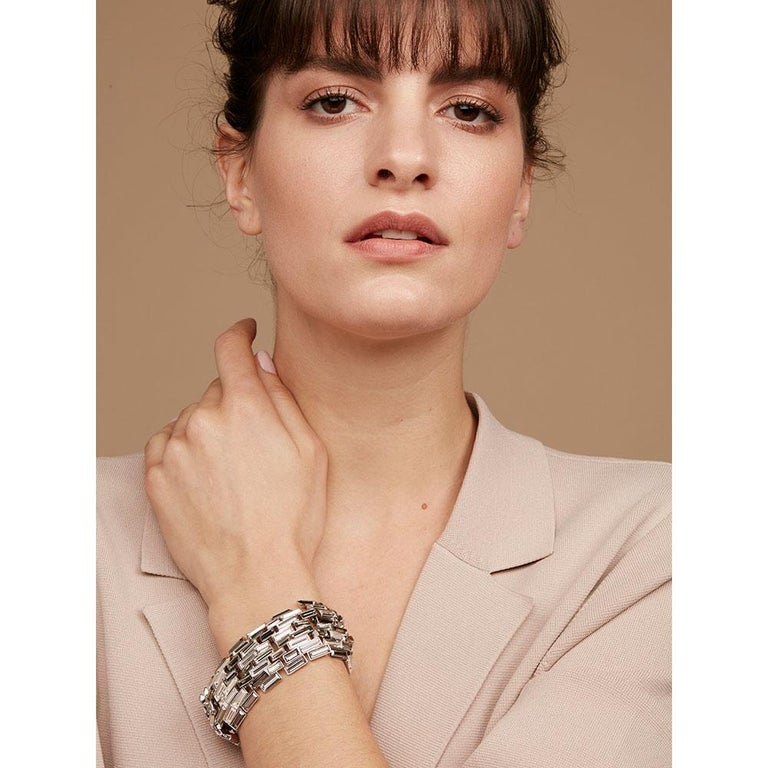 Like pure spring water, the Caddis crystal bracelet flows effortlessly around one's wrist, and with it's curved surface constantly reflects captured light in subtly different tones.  This collection evokes half-remembered childhood adventures by a