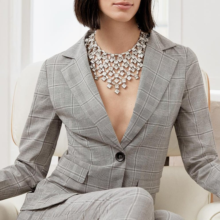 The Claudette Crystal Necklace flows elegantly around the neckline. The square Swarovski® crystals catch the light and the subtle changing tones of the crystals constantly sparkle. The Necklace makes a bold statement of the high glamour of the