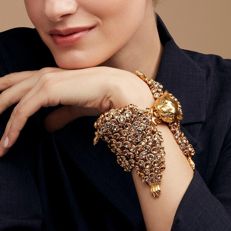 The Leopard bracelet is a playful interpretation of the Victorian leopard skin rug. When it is not being worn, it makes a great dressing table ornament. When worn the Leopard has a cleverly sprung jaw, so that it can bite its own tail to form the