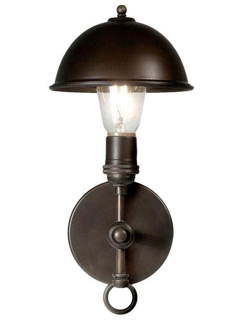 This lamp is so clean and simple it fits with almost any style. The 1920s style brass clip on Greist dome has a six inch diameter and can tilt in any direction.