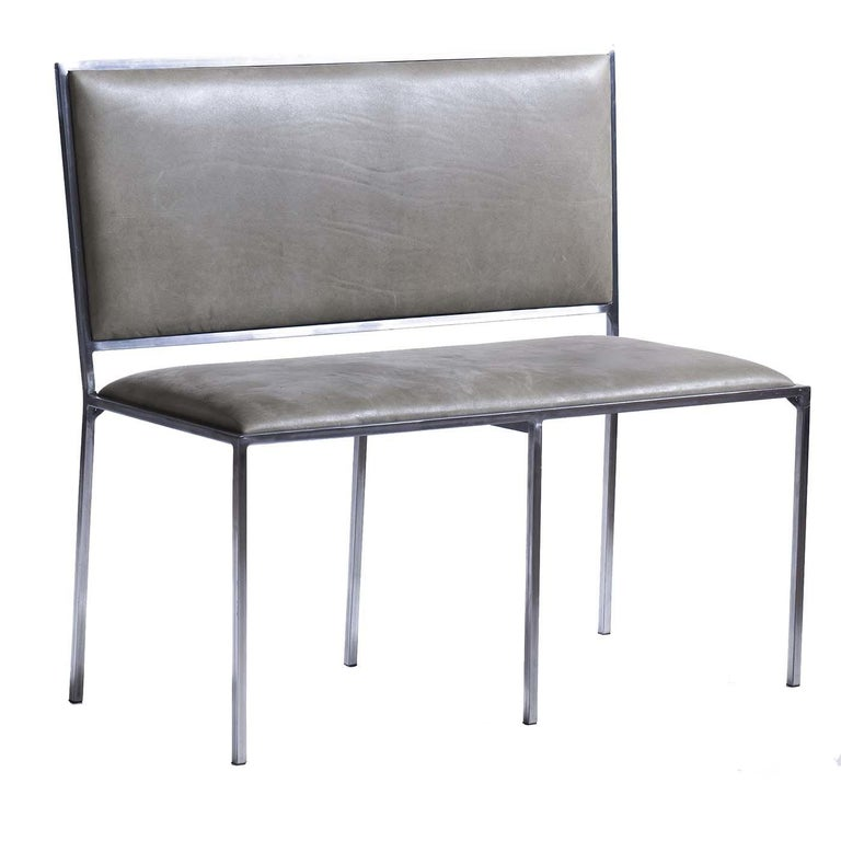 With its generous proportions and clean Silhouette, this is the perfect choice for a seating option that incorporates a sleek, contemporary look into any decor. Made of a simple, linear steel frame with a glossy polished finish, the back and seat of