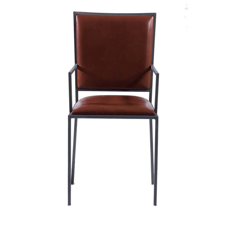 Understated yet elegant details inspired the name of this refined design that rests on a light steel structure metal in black powder-coated finish. The high backrest and square seat are upholstered in soft leather in a warm cognac color. An