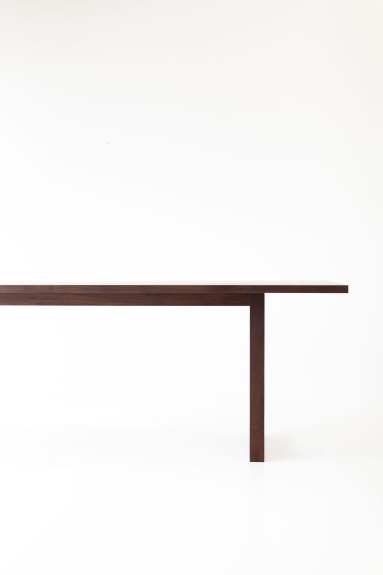 This simple modern dining table, walnut is made in the heart of Ohio with locally sourced wood. We use the table both as a harvest dining table or desk. Each table is handmade with solid black walnut and finished with a beautiful matte finish that
