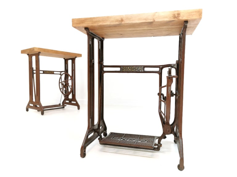 Two original singer sewing machine treadle stands fitted with a reclaimed wooden top.