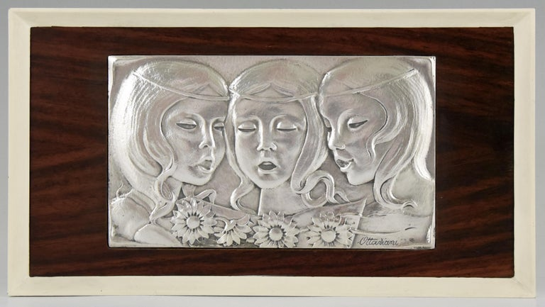 Mid Century Modern Sterling embossed and hammered Sterling silver wall panel with three singing girls signed by the Italian artist Ottaviani, 1960 in a wooden frame. 