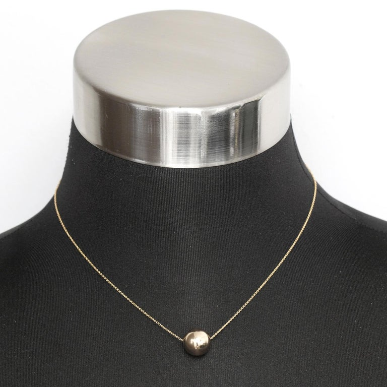 Single 14K Yellow Gold Ball Necklace  - 14K Yellow Gold 12 MM ball on a 14K Yellow gold chain. Total length 16 inch chain. Total weight 1.6 grams.