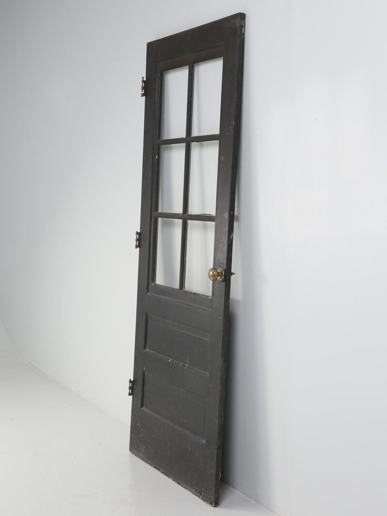 Antique painted French door with original brass hardware.
