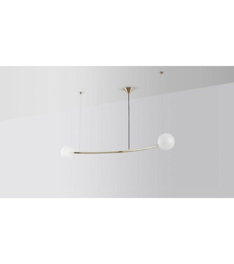 Single arc oddments chandelier by Volker Haug Dimensions: Diameter 110 x H 40 cm  Material: Brass.  Finish: Polished, Aged, Brushed, Bronzed, Blackened, or Plated Cord: Black Fabric Light: : G9 LED (110V - 240V) or G4 LED (12V) Glass Bulb: